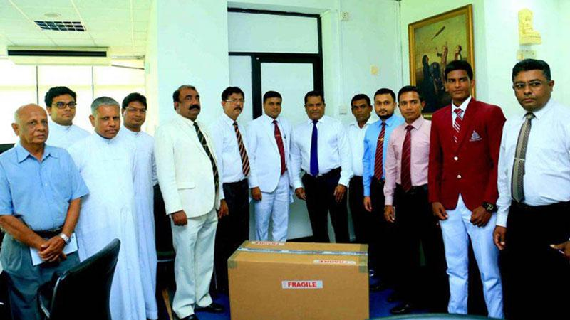 Sri Lanka Cricket president Shammi Silva presenting the first 16 bowling machines to Under-19 division one schools at a simple ceremony held at the SLC headquarters in the presence of Sri Lankan Schools Cricket Association president Thilak Wattuhewa, school principals and masters in charge of school teams