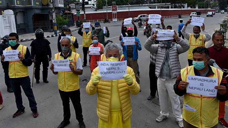 Activists protest against India's newly inaugurated link road to the Chinese border, near the Indian embassy in Kathmandu