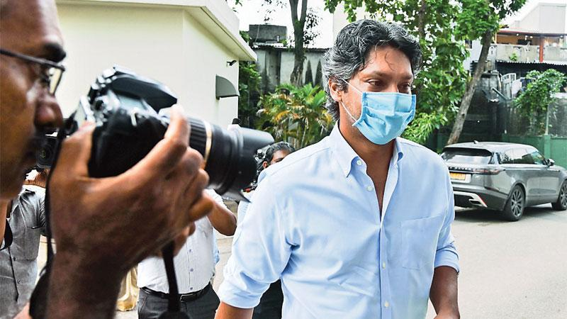 Sri Lanka's Kumar Sangakkara, the captain of the losing side at the 2011 Cricket World Cup, arrives at the Special Investigation Unit to be interviewed by police in Colombo reads the caption of this AFP photo taken by Lakruwan WANNIARACHCHI for international consumption