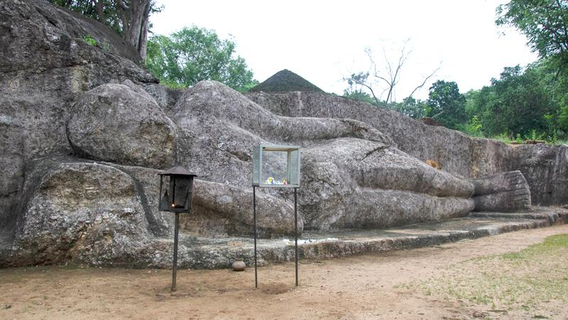 The rock-hewn recumbent Buddha statue of Ataragalleva in Elahera