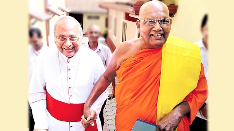 His Eminence Malcolm Cardinal Ranjith given a hand by Ven. Dr. Ittapana Dharmalankara Thera, the Mahanayake of Kotte Sri Kalyani Samagri Dharma Maha Sanga Sabha of Siyam Maha Nikaya