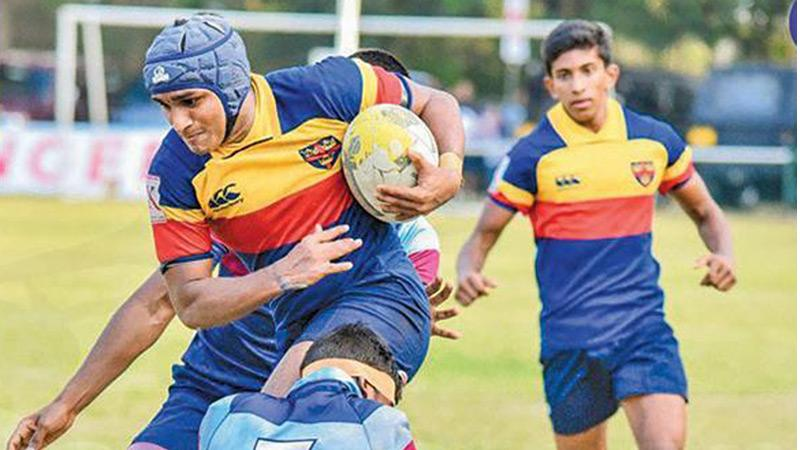 In this picture taken by ThePapare website schoolboys from Trinity College and St. Anthony's College feature in their rugby match in the 2020 season that came to an end after just two weeks