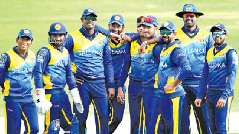 Members of the Sri Lanka team come together at the 2019 World Cup
