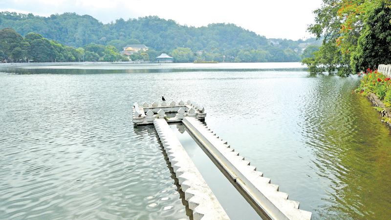 The man-made Kandy Lake and niched parapets