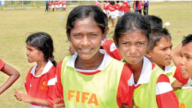 Young girls come together at a football camp