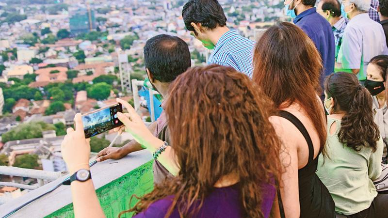 Guests watching the sunset from the 37th floor of Prime Grand, Ward Place