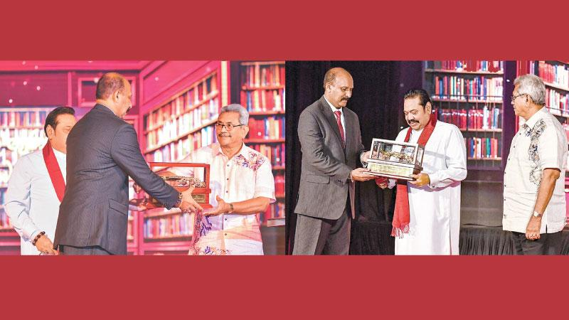 Defence Secretary Major General (Rtd) Kamal Gunaratne presents mementoes to the President and the Prime Minister