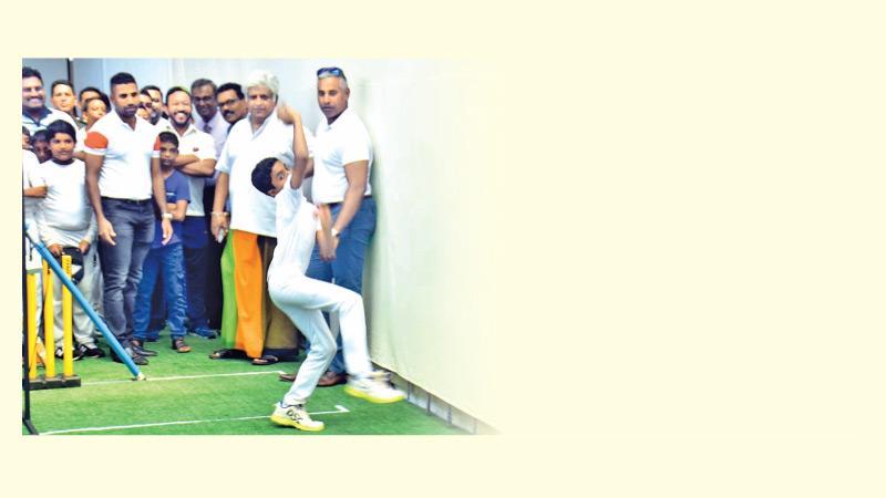 Arjuna Ranatunga and Chaminda Vaas watch a young bowler at the nets