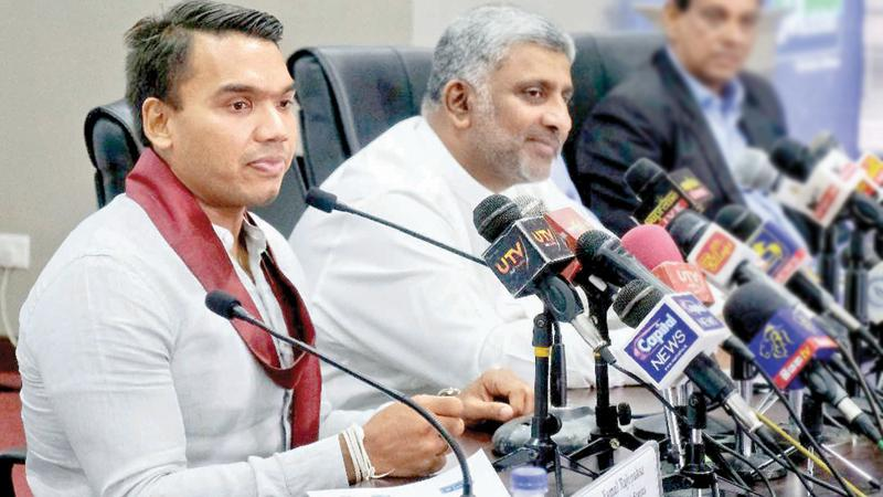 Sports Minister Namal Rajapaksa (left) and Minister of Tourism Prasanna Ranatunga talk to the media. Minister Rajapaksa became the proud father of his first born, a baby boy yesterday (Pic by Sulochana Gamage)