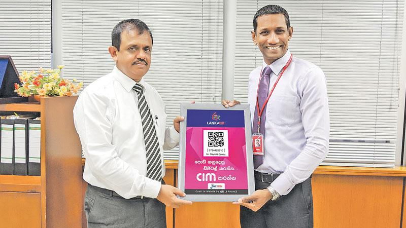 D. Kumaratunge, Director Payments and Settlements of CBSL (left), and Bimal Perera, Head of Digital Financial Services, LBF.
