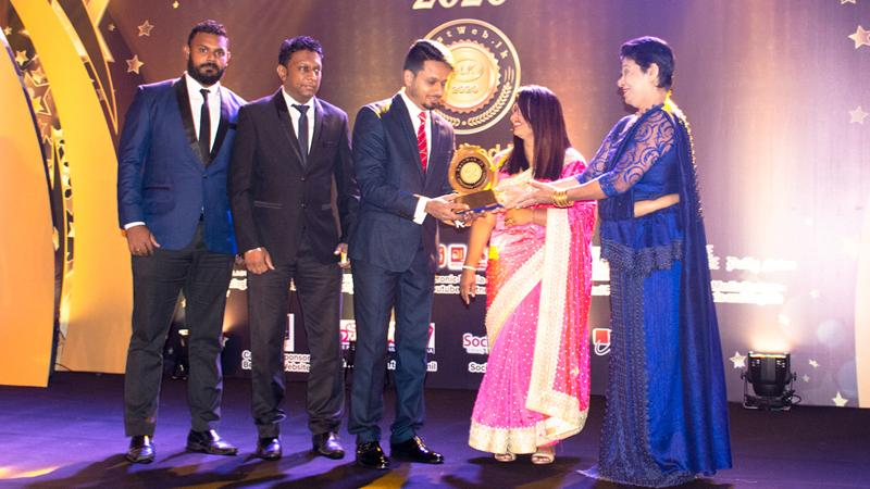 From left: Digital Media, Dineth Silva, Assistant General Manager, Dushantha Rangana and Director of Prime Group, Ruminda Randeniya receive the Gold award for the 'Best Corporate Website in Sri Lanka'.