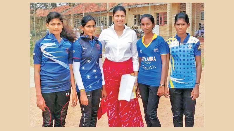 Sri Lanka women's cricket convener Apsari Tillekaratne poses with Jaffna school cricketers during her visit to the northern province