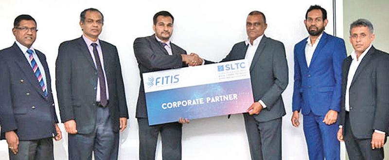 At the presentation of the cheque: From left : Aruna Alwis, CEO FITIS, Dr. Prasad Samarasinghe, Senior Vice Chairman FITIS,  Abbas Kamrudeen, Chairman FITIS, Ranjith G. Rubasinghe, CEO, SLTC,  Nuwan Dishan, Lead Corporate Education and Dr. Dhammika Elkaduwa, Head of School of Computing and IT.