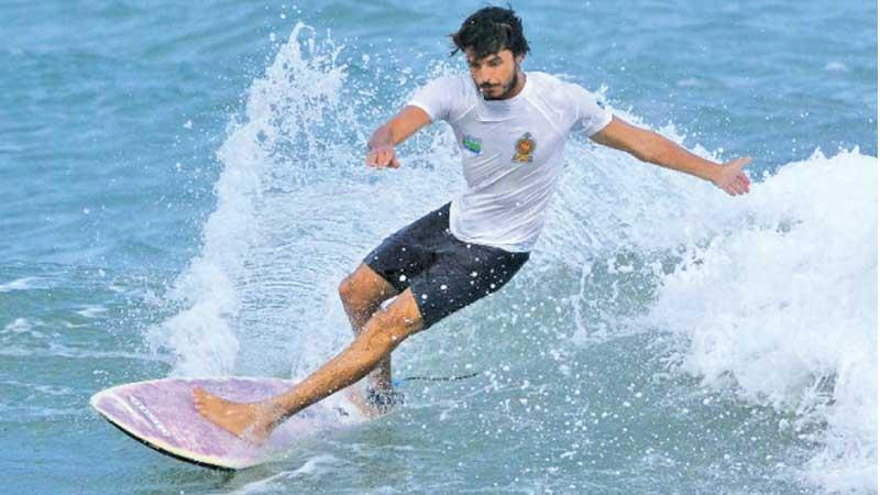 Lakshitha Madushan who won the National surfing title rides the waves at Arugam Bay in Pottuvil in the eastern province (Pic by Sulochana Gamage)