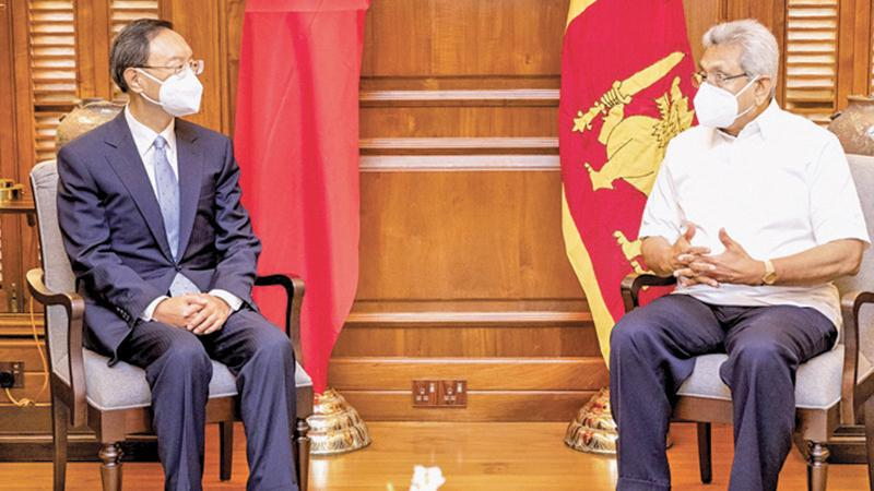 Former Chinese Foreign Minister and the current Communist Party Political Bureau Member Yang Jiechi in conversation with  President Gotabaya Rajapaksa