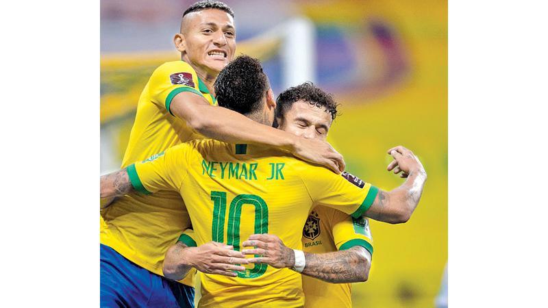 Brazil's Roberto Firmino celebrates his goal