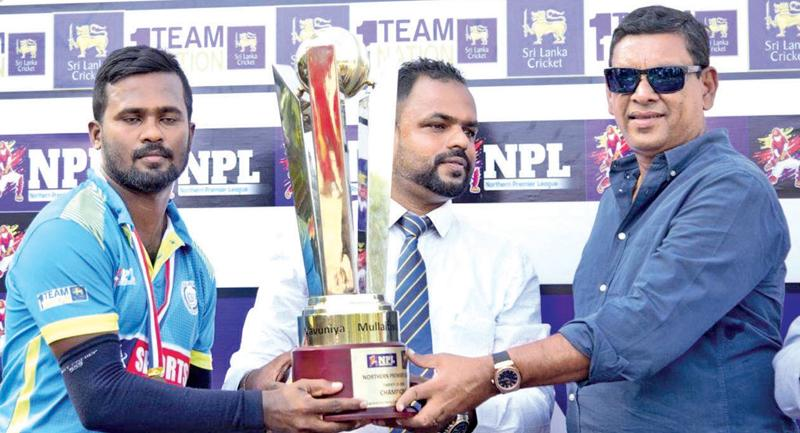 Skipper of the Jaffna Gladiators S. Niroshan receiving the Champion trophy from   Sri Lanka Cricket vice president Ravin Wickramaratne