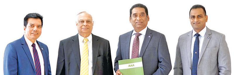 Representatives of the senior management of Commercial Bank's Bangladesh operation with the AAA rating certificate. (From left:) Financial Controller Binoy Gopal Roy, Senior General Manager Dilip Das Gupta, CEO Varuna Kolamunna and Chief Operating Officer Kapila Liyanage.