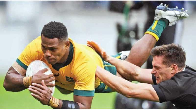 Australian winger Filipo Dauguna beats the New Zealand defence to score in the first Test that ended in a 16-16 thriller at Wellington last Sunday as the match was carried forward without a breakdown for nearly 10 minutes after the end hooter was blown