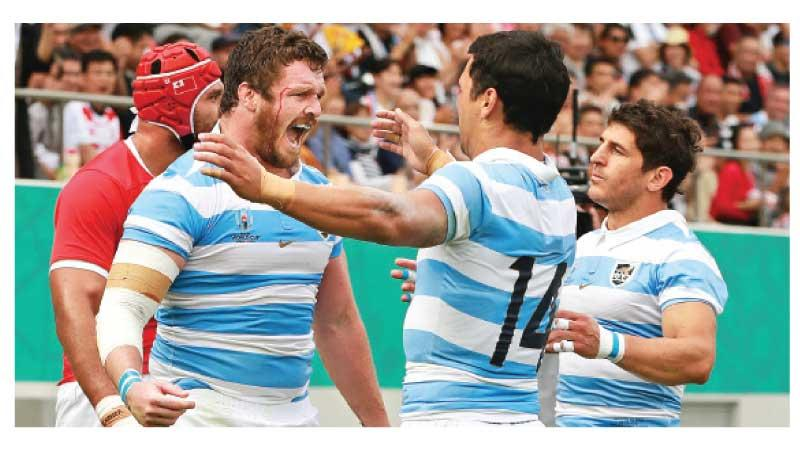 File photo of Julian Montoya (L) of Argentina celebrates scoring
