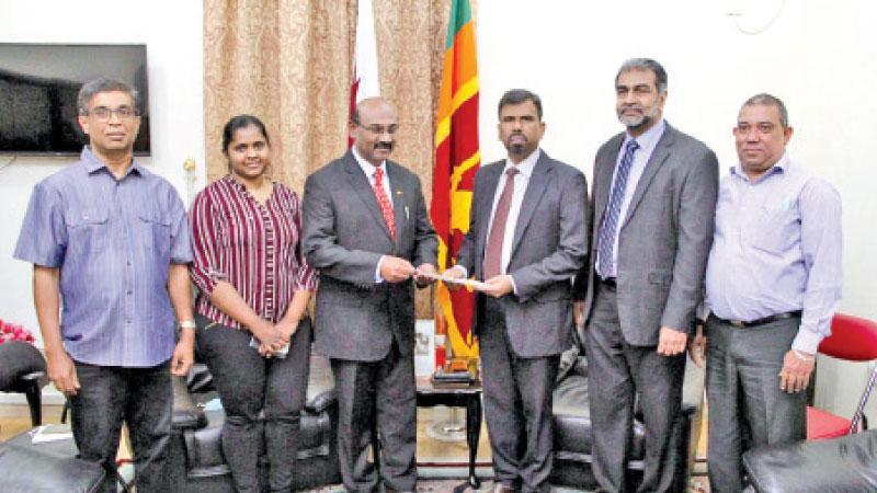Charge de affaires Ratnasingam Kohularangan presents the affiliation letter to the President of the Sri Lankan Entrepreneurs Association, Prince Stephen.