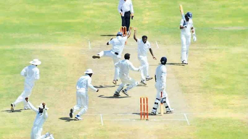 Muralitheran celebrates taking his 800th wicket in a Test match against India in Galle in 2012 before retiring