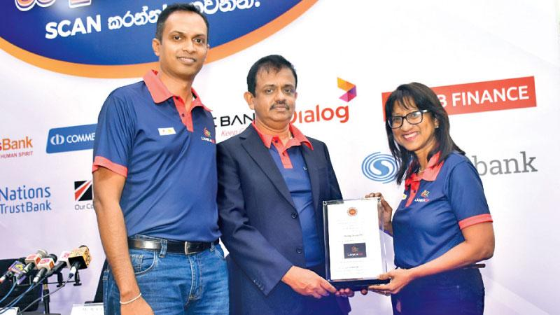 At the launch. From left: Padmanath Muthukumarana, Senior Manager, Mobile Financial Services, Dialog Axiata, D. Kumaratunge, Director, Payments and Settlements Department, Central Bank of Sri Lanka, and Renuka Fernando, Chairman, Dialog Finance and Chief Digital Services Officer of Dialog Axiata.