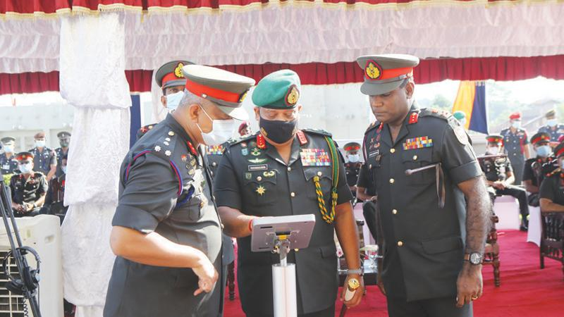 Army Commander Lt. Gen. Shavendra Silva inspects the drones