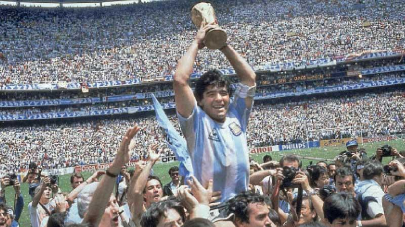 Diego Maradona with the World Cup in 1986