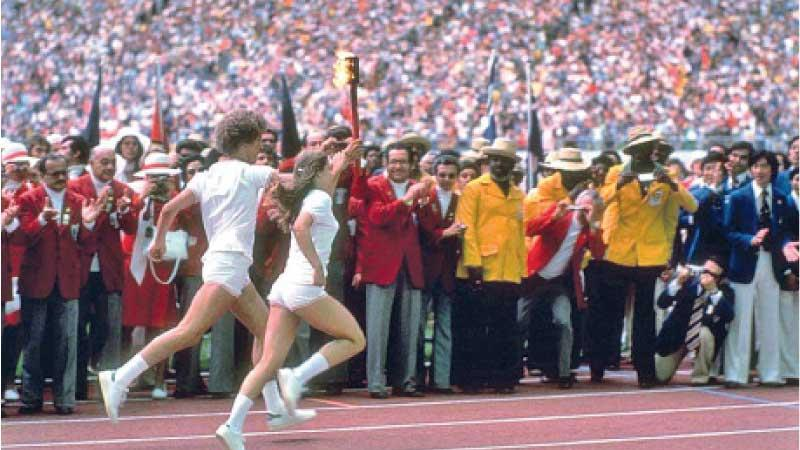 First duo to light Olympic Flame, Stephane Prefontaine and Sandra Henderson