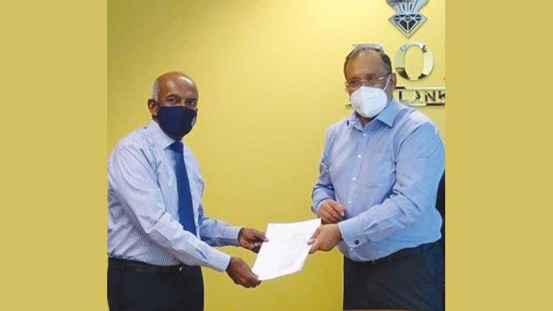 Managing Director of Tokyo Cement Company (Lanka) PLC, S.R. Gnanam and  Chairman of the BOI, Susantha Ratnayake exchange the agreement.