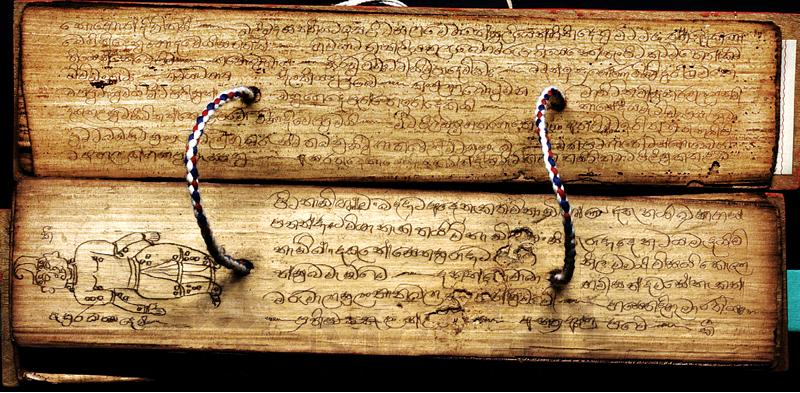 Ancient palm-leaf manuscripts with diagrams for vita (nila) points treatments and methods.
