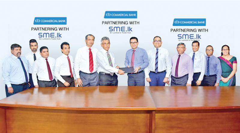ComBank and Bellvantage officials after signing the MoU.