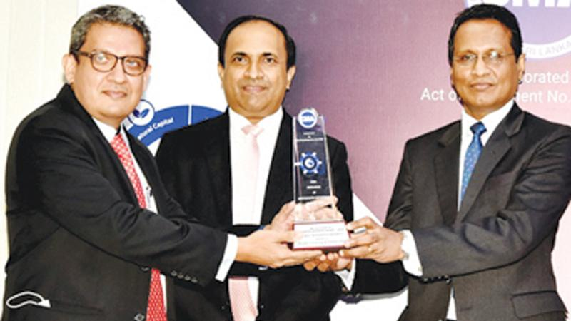 CEO and GM, PLC, Shamindra Marcelline receives one of the awards.