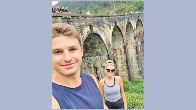 Beauden Barrett with his wife during a tour of Sri Lanka where he poses near the landmark Nine Arch Bridge at Ella in the Budulla district after trekking along the rail track through tea estates and vegetation for one and a half hours