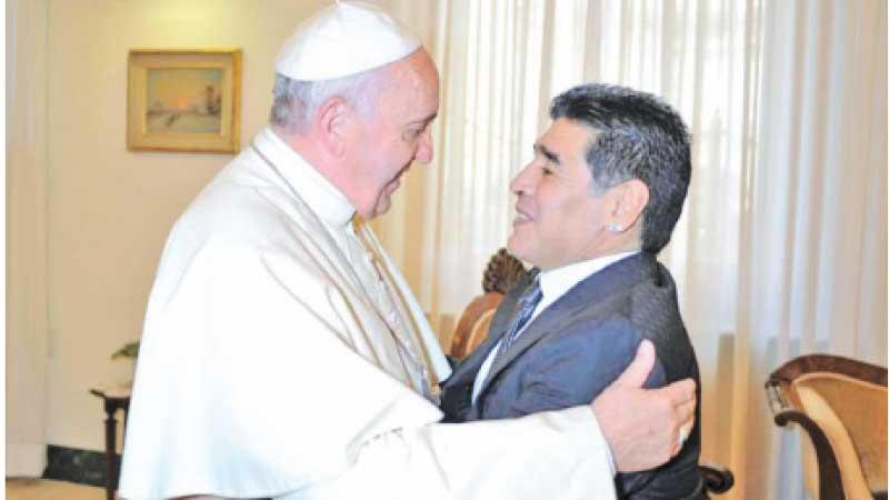 Pope Francis who was once a football goal keeper during his youth in Argentina meets fellow Argentine legend Diego Maradona in this file photo during a Vatican audience