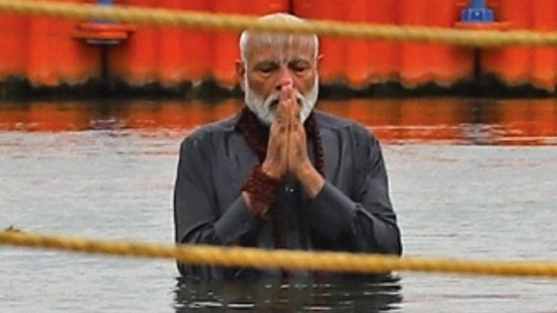 Indian Prime Minister Narendra Modi prays after taking a dip on the confluence of the Ganges, Yamuna and mythical Saraswati rivers, during 'Kumbh Mela' in Prayagraj