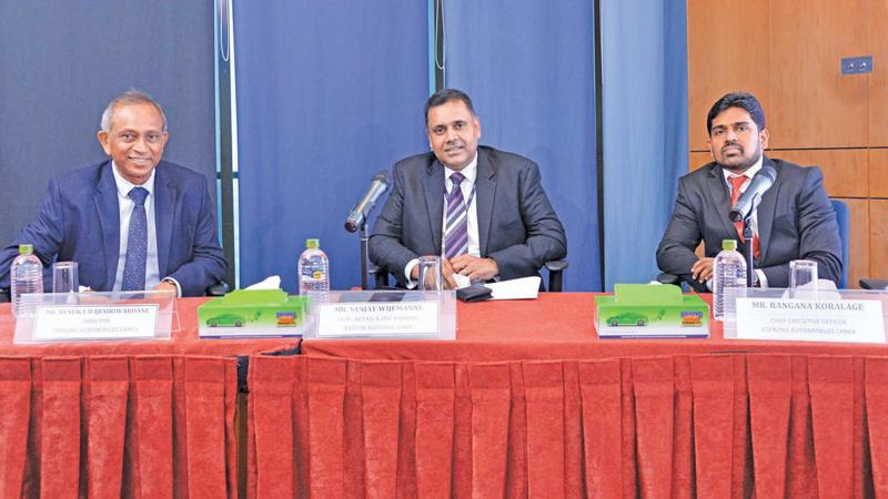 From left: Director, Sterling Automobiles Lanka, Renuka Wijesiriwardane,  DGM, Retail and SME Banking, Hatton National Bank, Sanjay Wijemanne  and  CEO, Sterling Automobiles Lanka, Rangana Koralage.