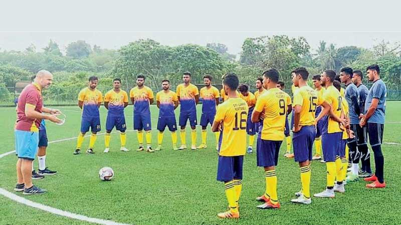 Sri Lanka football players listen to a lecture by head coach Amir Alagic