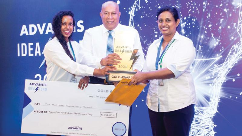 Sadna Dissanayake and Lakshika Porage receive the Gold Award from Hayleys PLC Chairman and Chief Executive, Mohan Pandithage.