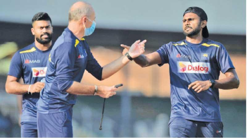 As their keepers were investigated for financial misdeeds, some of Sri Lanka's cricketers also failed a fitness test ahead of a major tour of the West Indies. Isuru Udana (right) who passed the test talks to Grant Luden physical performance manager