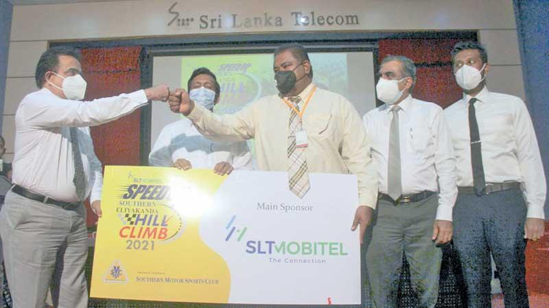 Chief Marketing Officer of SLTMobitel Prabath Dahanayake presents the sponsorship to the president of the Southern Motor Sports Club Dr. Sanjaya Sedera Senarath. The other co-sponsors for the Hill Climb are Mobil, Wurth, Merchant Bank and Motor Sports Network as the Media Partner. (Pic by Saliya Rupasinghe)