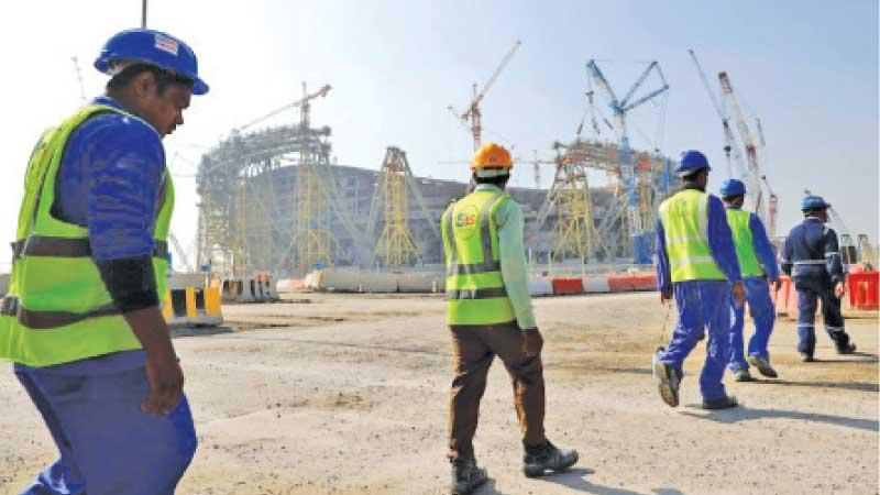 Workers at a construction site of a World Cup venue in Qatar