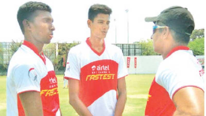 Flashback to May 2019: Chaminda Vaas imparts fast bowling tips to two village boys, Steven Soosai (left) and MRM Rimzi at a private clinic in Colombo