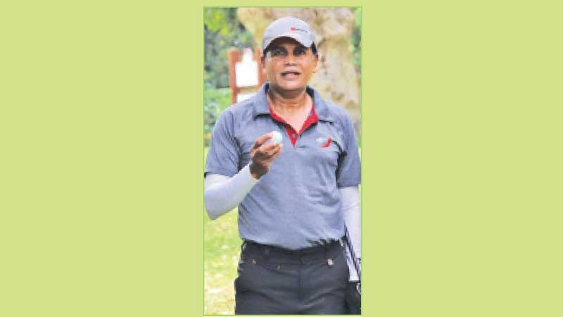 Ravi Liyanage with  the hole in one ball