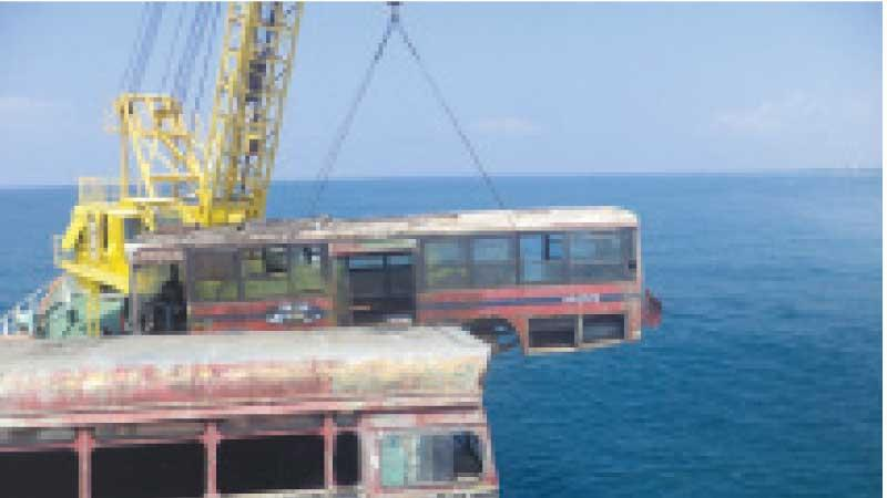 Scrapped buses loaded aboard the Sayura