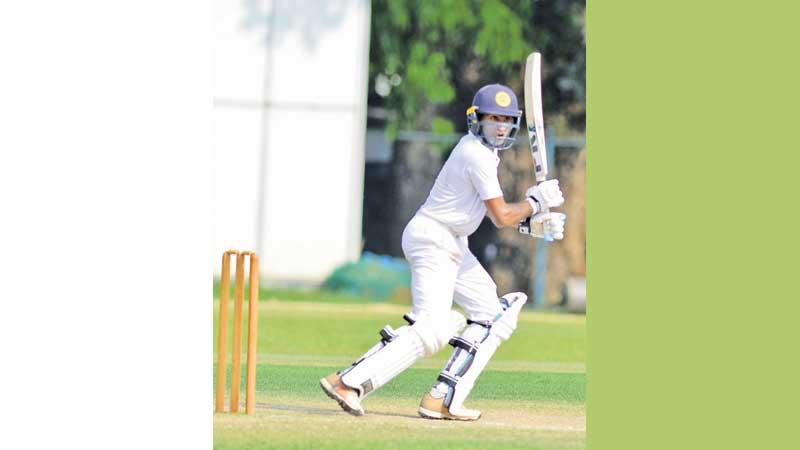 Mahanama College batsman Pavan Ratnayake cuts a ball to the boundary during his half century (75) in the second innings against Thurstan College at Thurstan ground yesterday. He made a hundred in the first innings (Pic Hirantha Gunathilaka)