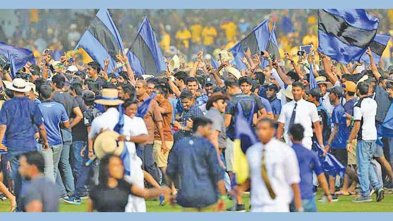 Flags flutter at the Royal-Thomian