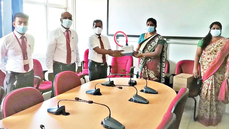 From left: Ceylinco Life's Manager Business Development, K. Sumanthiran, Assistant Regional Sales Manager S. Venukaran and Senior Business Promotion Manager N. Pushpaharan present the equipment to the Director of the Hospital, Dr. K. Ganeshlingam and Deputy Director Dr. M. Barthelot.