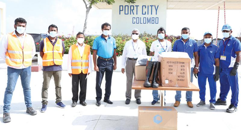 Officials of Port City Colombo and MEPA at the presentation of PPE